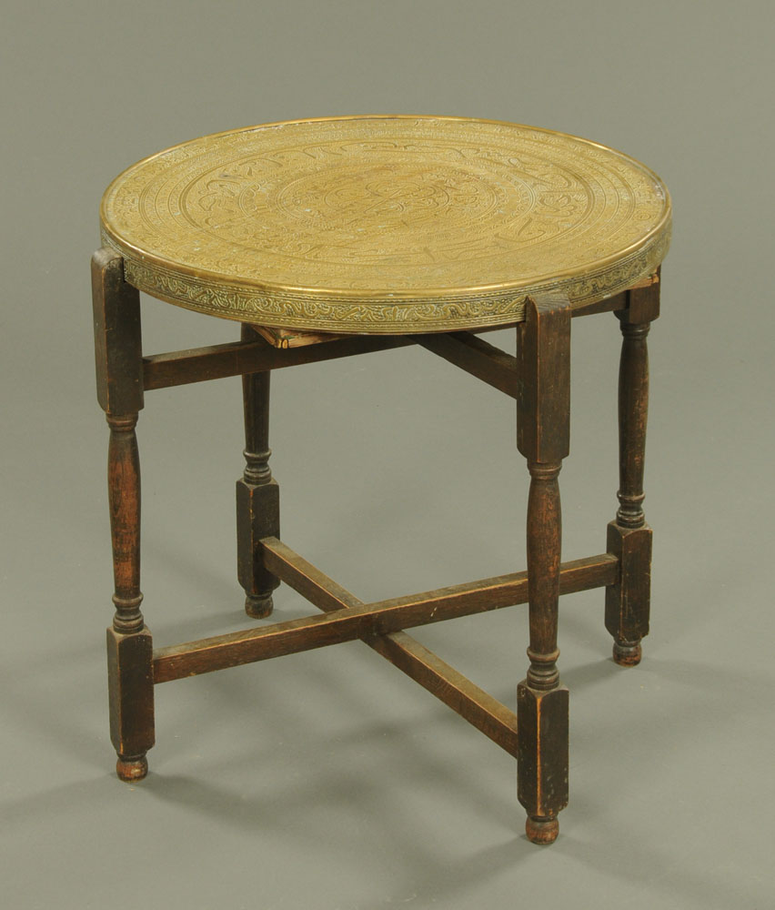 An Eastern brass topped circular occasional table,