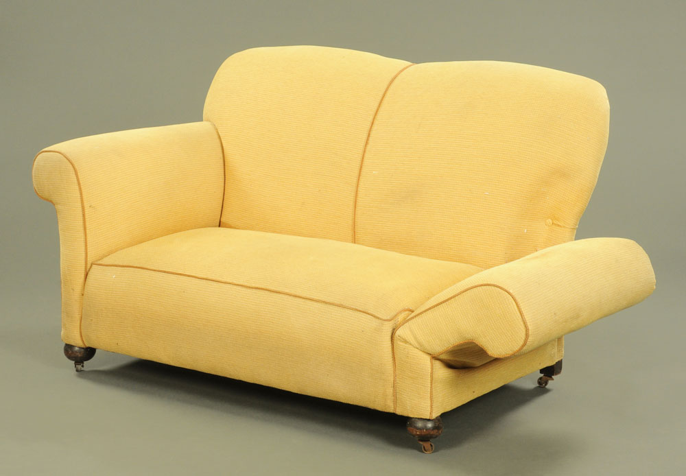 An Edwardian drop end two seat settee, upholstered in yellow cloth on turned front legs and castors. - Image 2 of 2
