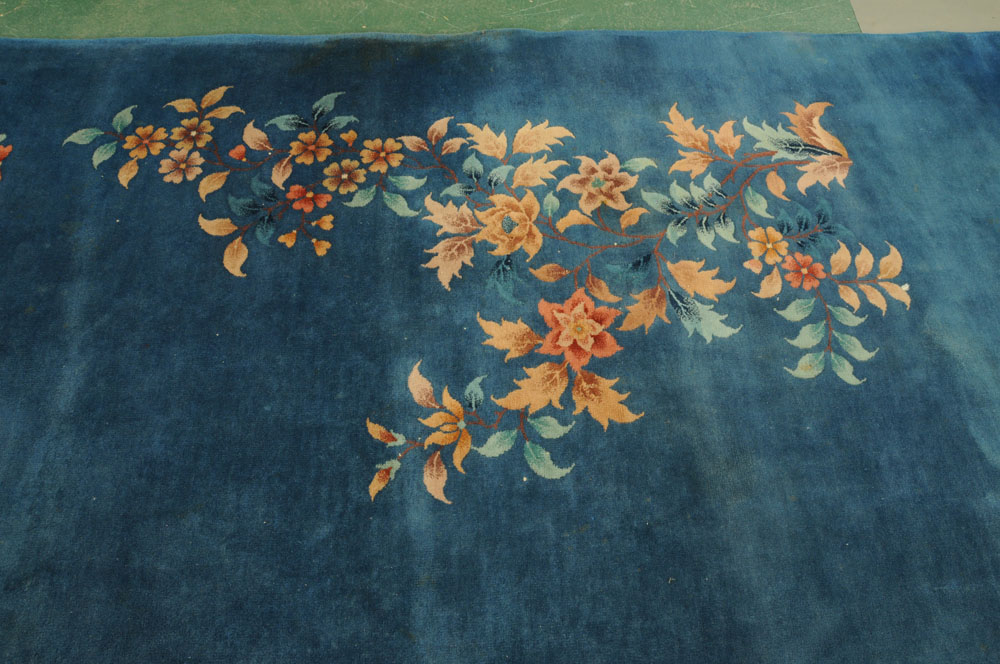 A large Chinese blue ground foliate patterned carpet with fringed ends. - Image 4 of 8