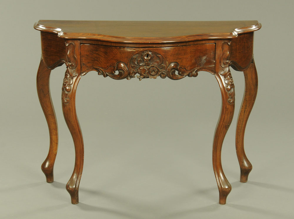 A continental walnut serpentine fronted hall table,
