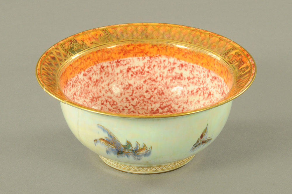 A Wedgwood lustre bowl, decorated with butterflies, as found. diameter 21.5 cm.