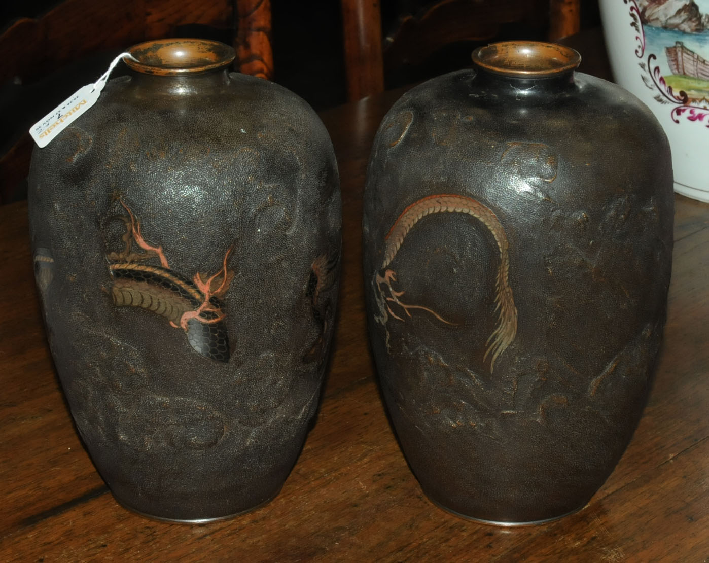 A pair of Japanese bronze vases, decorated with chasing dragons. Height 26 cm. - Image 3 of 11