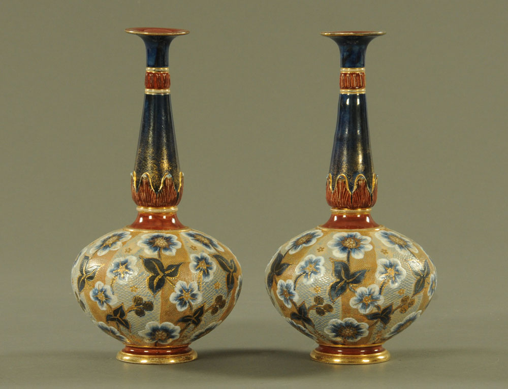 A pair of Doulton Slaters patent club shaped vases, with mottled ground painted with flowers,
