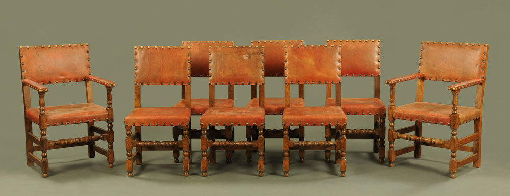 A set of eight oak Commonwealth style dining chairs, comprising two arm and six single chairs,