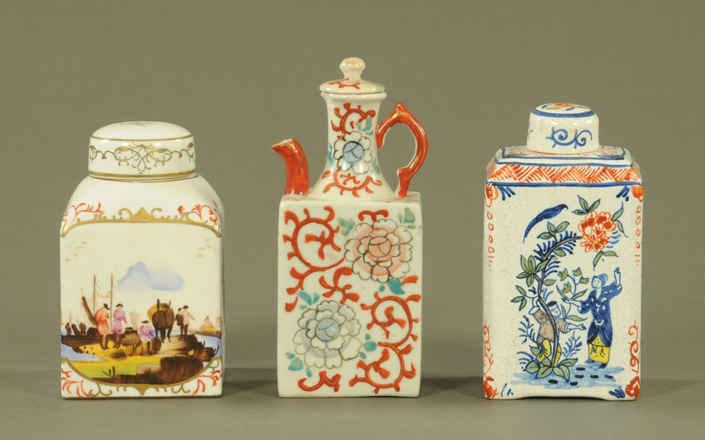 Two continental tea caddies, one porcelain, one Dutch Delft together with a small lidded wine flask.