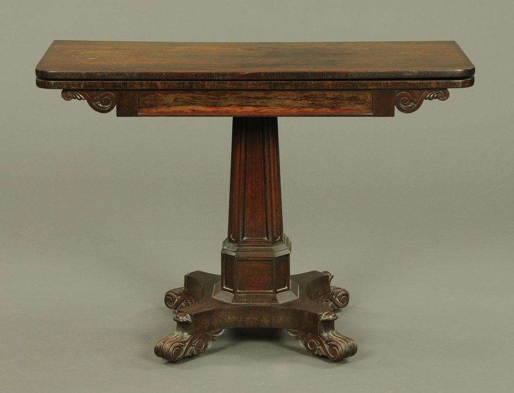 An early 19th century rosewood turnover top tea table, with rounded corners, faceted centre column,