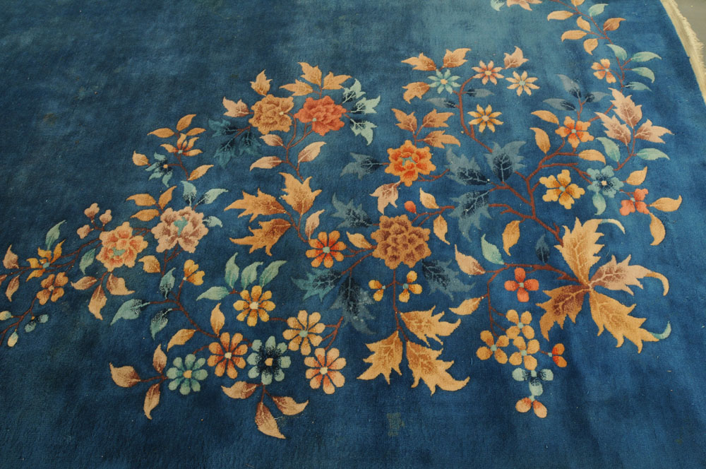 A large Chinese blue ground foliate patterned carpet with fringed ends. - Image 2 of 8