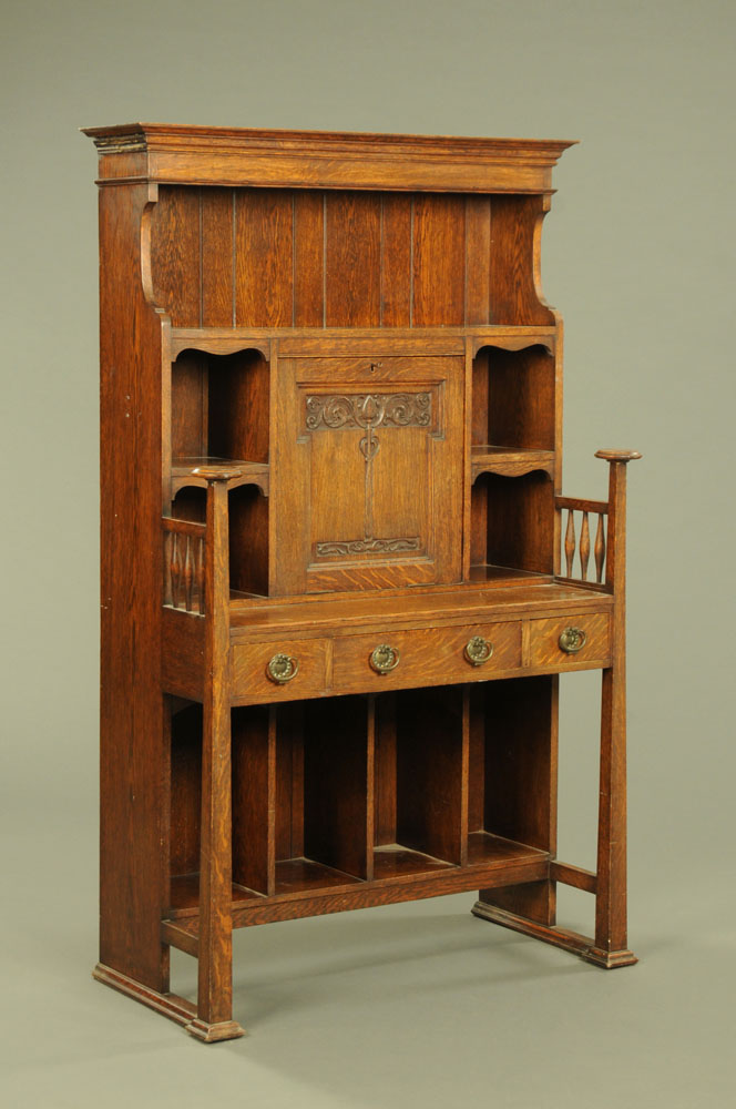 A late 19th / early 20th century Art Nouveau oak secretaire cabinet, with a series of shelves,