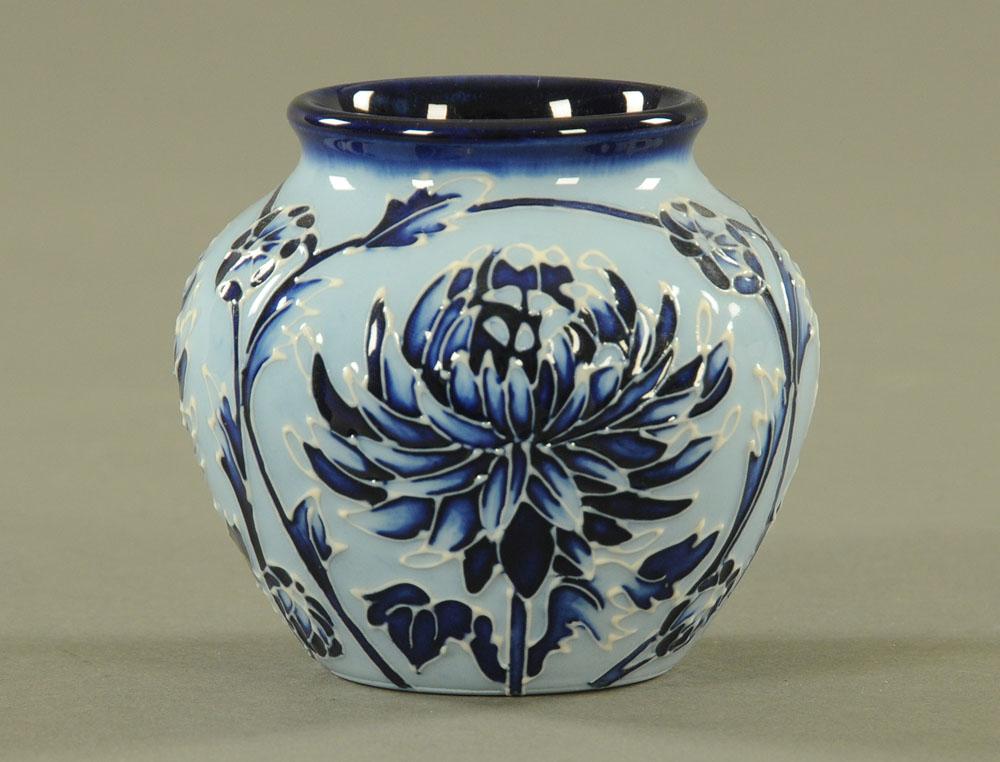 "A Moorcroft ""Blue Chrysanthemum"" vase, 2003. Height 7.5 cm."