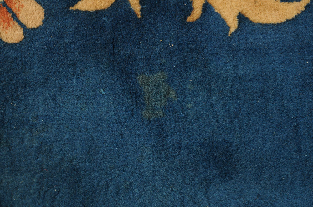 A large Chinese blue ground foliate patterned carpet with fringed ends. - Image 8 of 8
