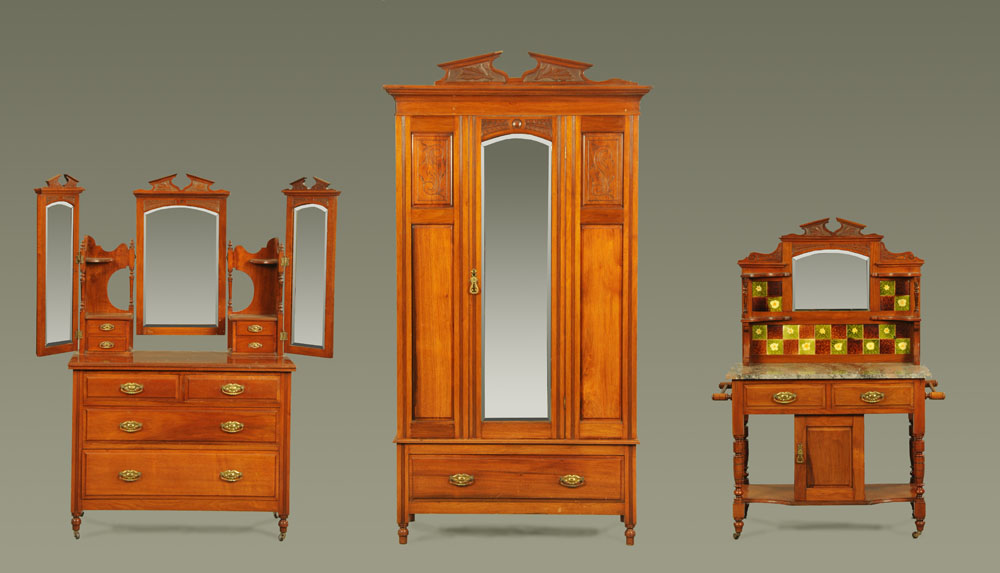 A Victorian walnut bedroom suite, comprising wardrobe, dressing table and washstand.