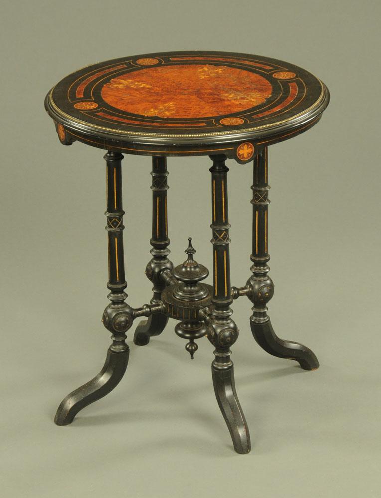 A James Shoolbred & Co London ebony and amboyna inlaid circular table,
