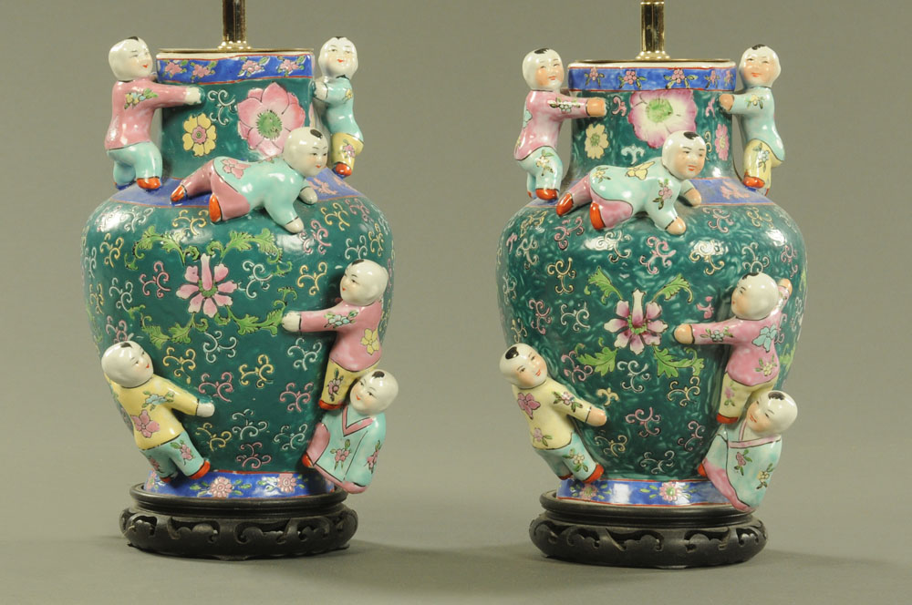 A pair of Chinese porcelain baluster vases, decorated in green,