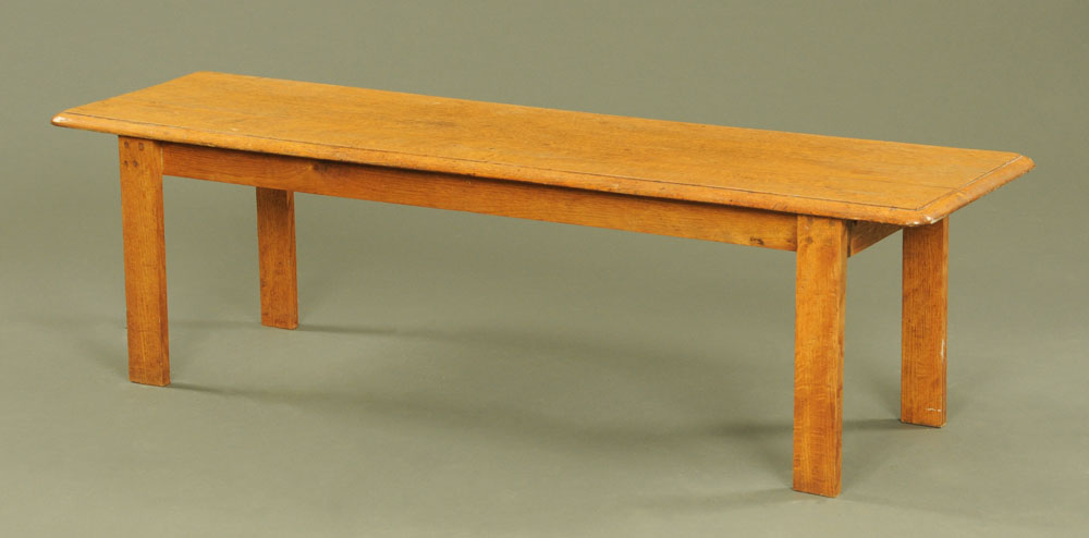 A late Victorian oak rectangular bench, the top with moulded edge on plain legs.