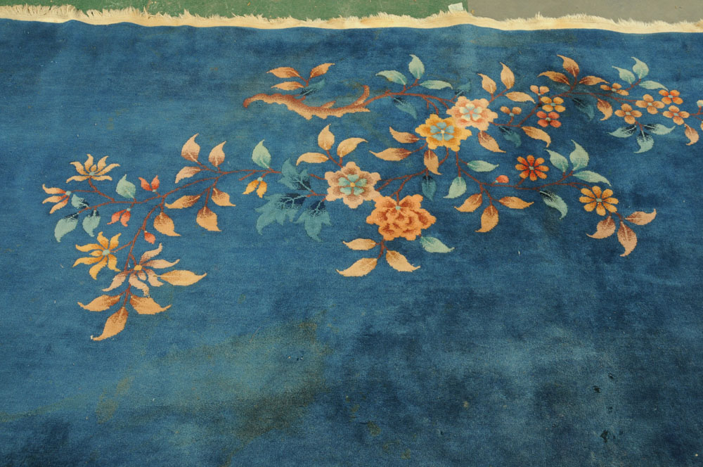 A large Chinese blue ground foliate patterned carpet with fringed ends. - Image 3 of 8