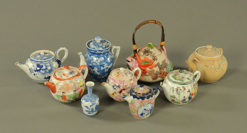 A collection of eight late 19th century and later oriental teapots, various.