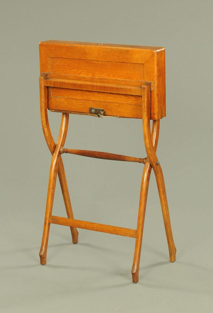 A late Victorian oak campaign writing desk. Width 55 cm.