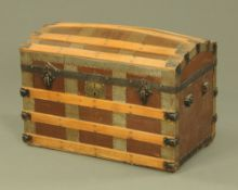 A late Victorian brown cloth and wood bound domed top travelling trunk.
