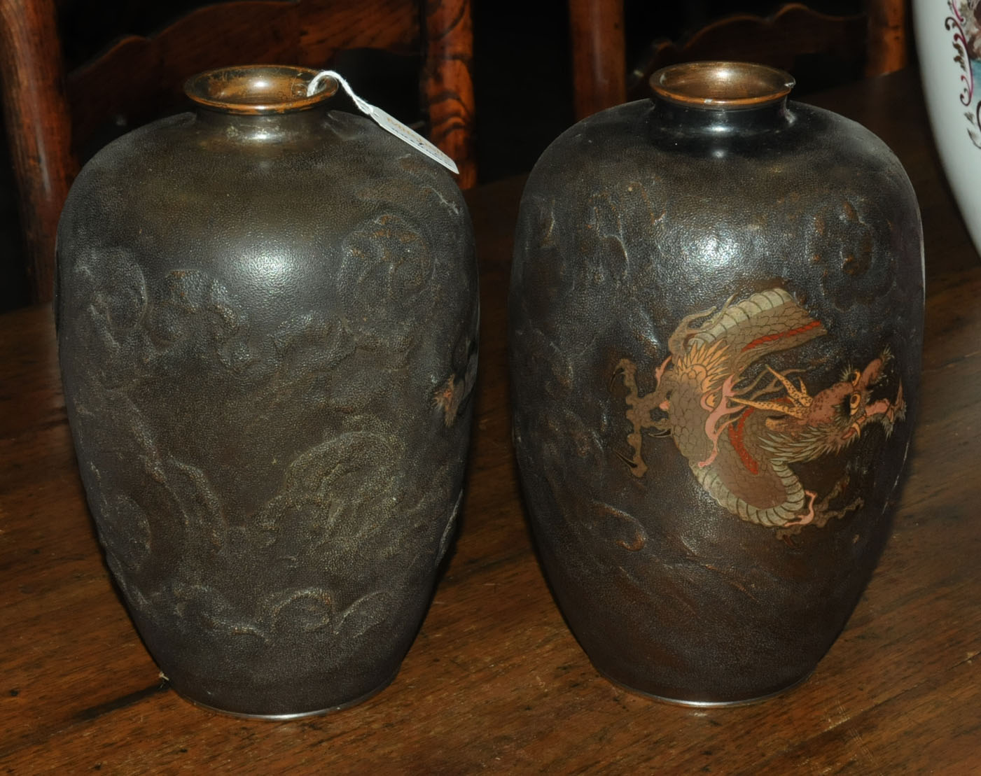 A pair of Japanese bronze vases, decorated with chasing dragons. Height 26 cm. - Image 5 of 11