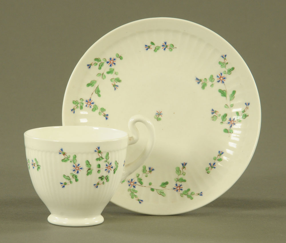 An early 19th century Swansea pottery coffee cup and saucer,