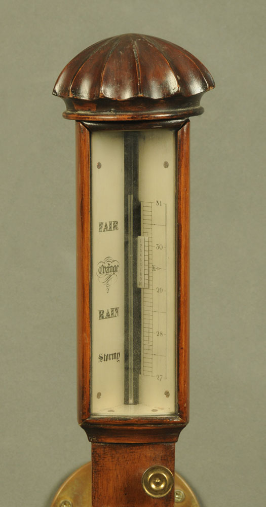 A marine barometer, in the Regency style, mahogany with twist case and complete with brass gimbal. - Image 2 of 2