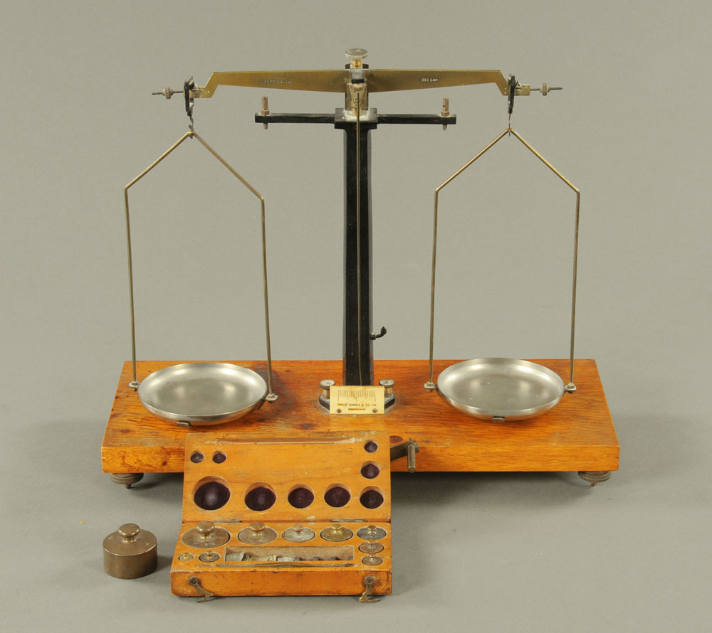 A Philip Harris & Co balance scale, together with a cased set of Becker weights.