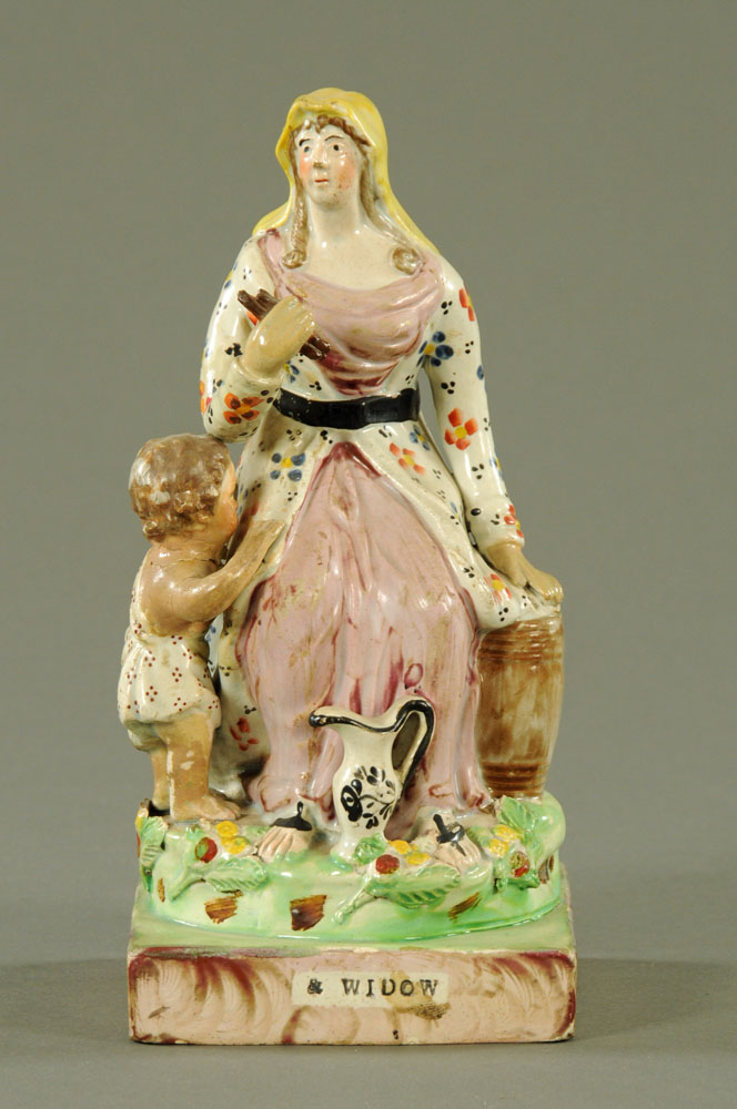 """An early 19th century Staffordshire pearlware figure """"A Widow"""". 24 cm high."""
