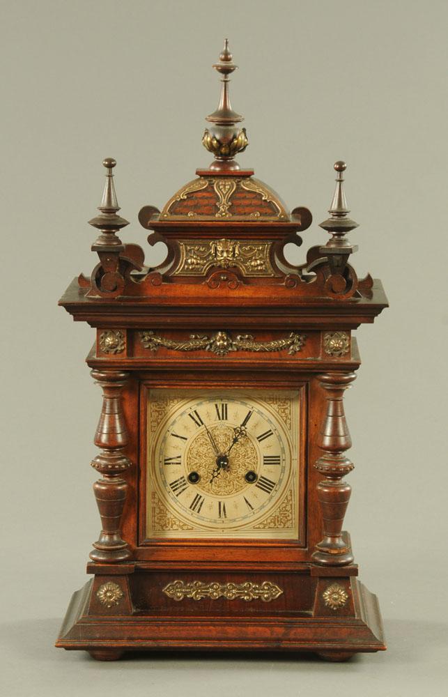 An Edwardian walnut brass mounted mantle clock,