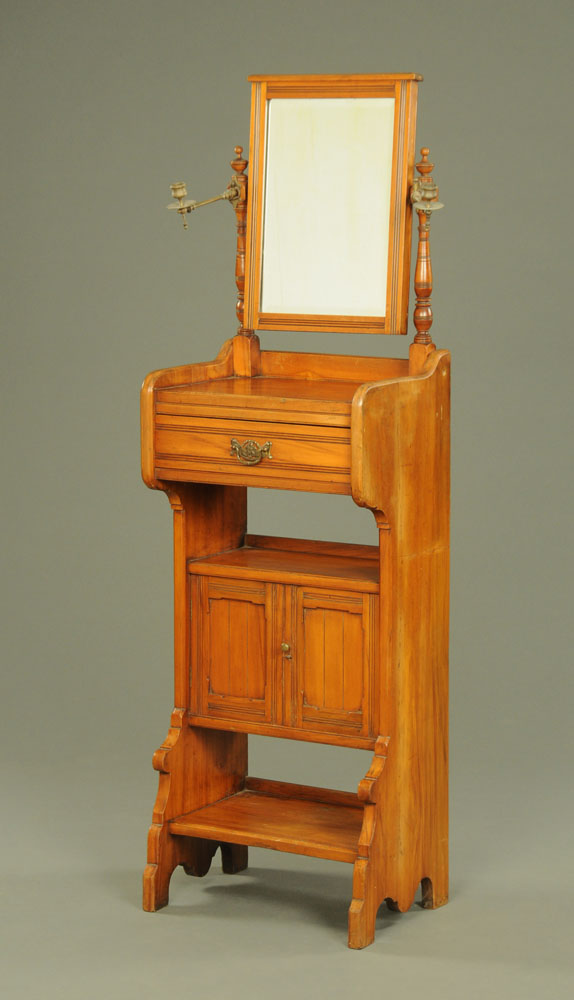 A late Victorian walnut dressing stand, with mirror, drawer,
