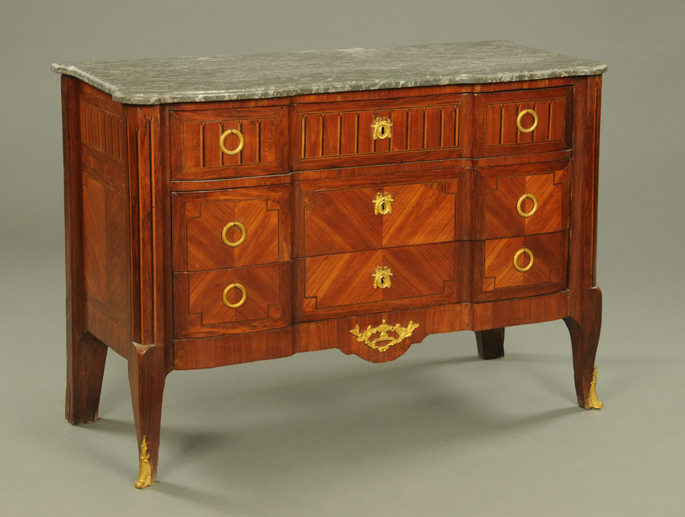 A 19th century continental marble topped commode chest of three drawers,