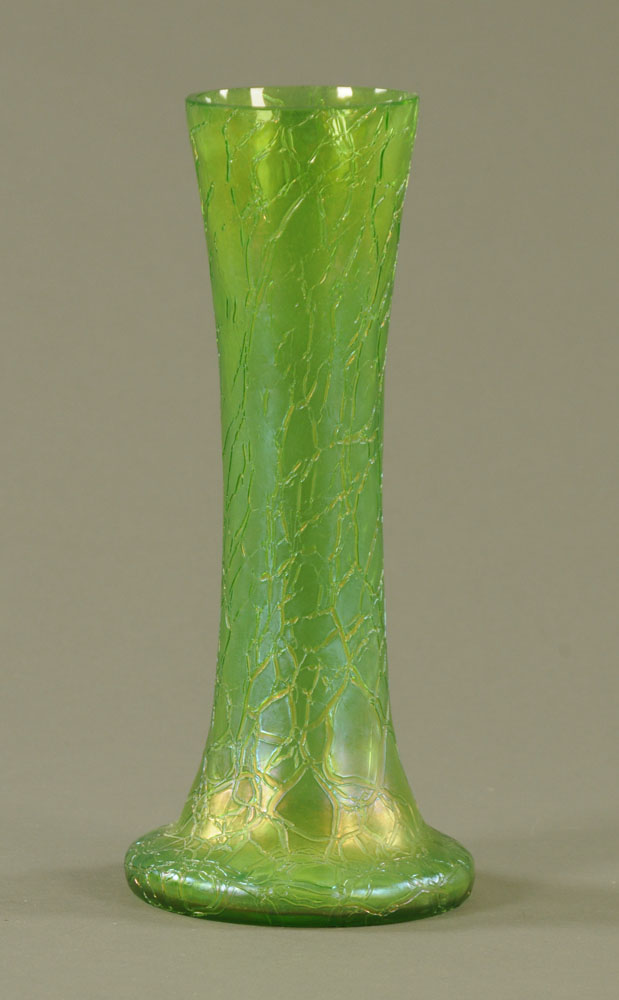 An early 20th century Loetz style iridescent green crizzled glass cylindrical vase,