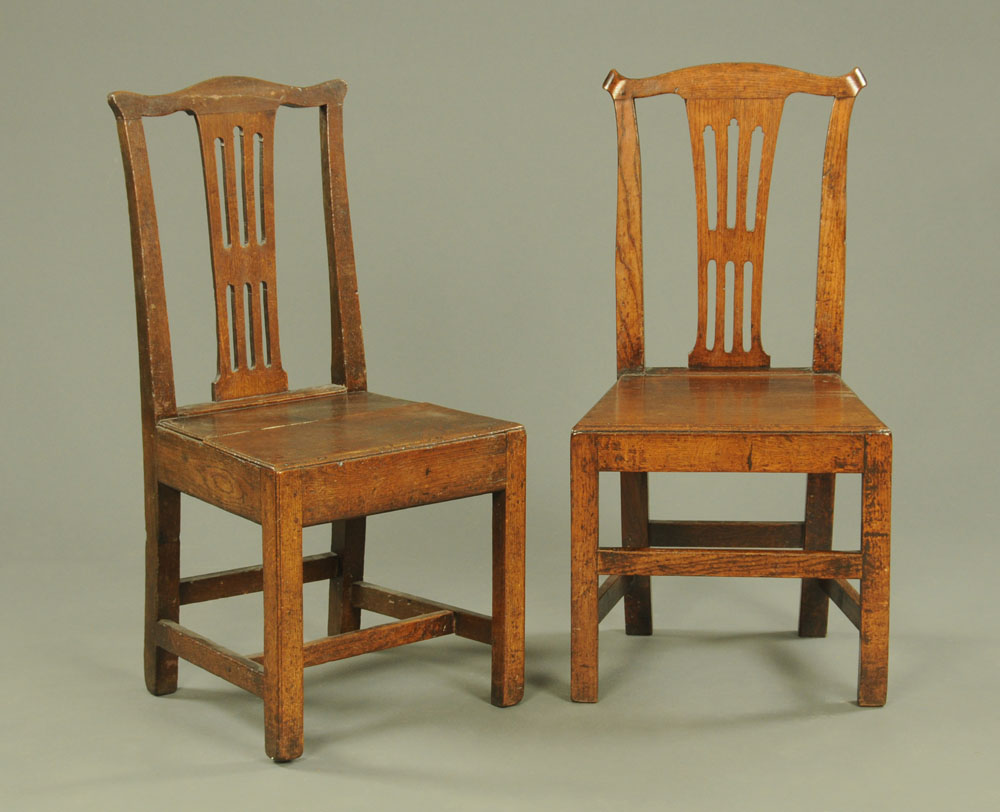 A pair of George III oak side chairs.