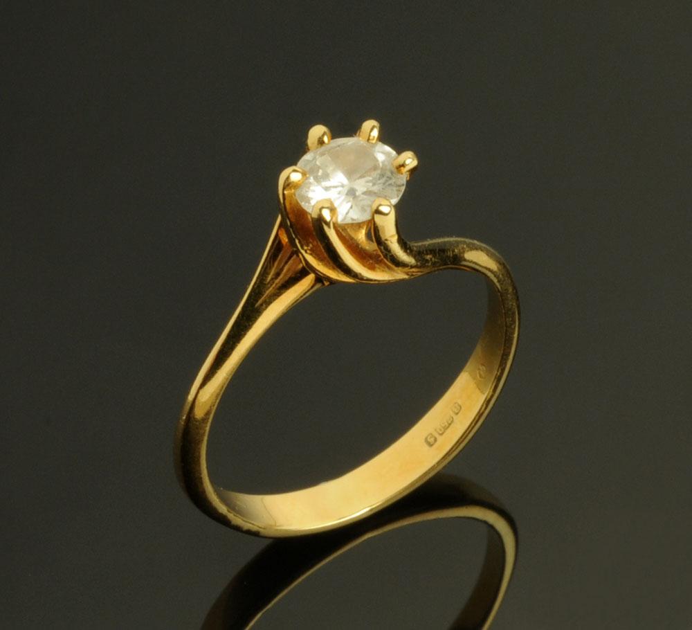An 18 ct gold diamond solitaire ring, circa .5 carat, Size M.