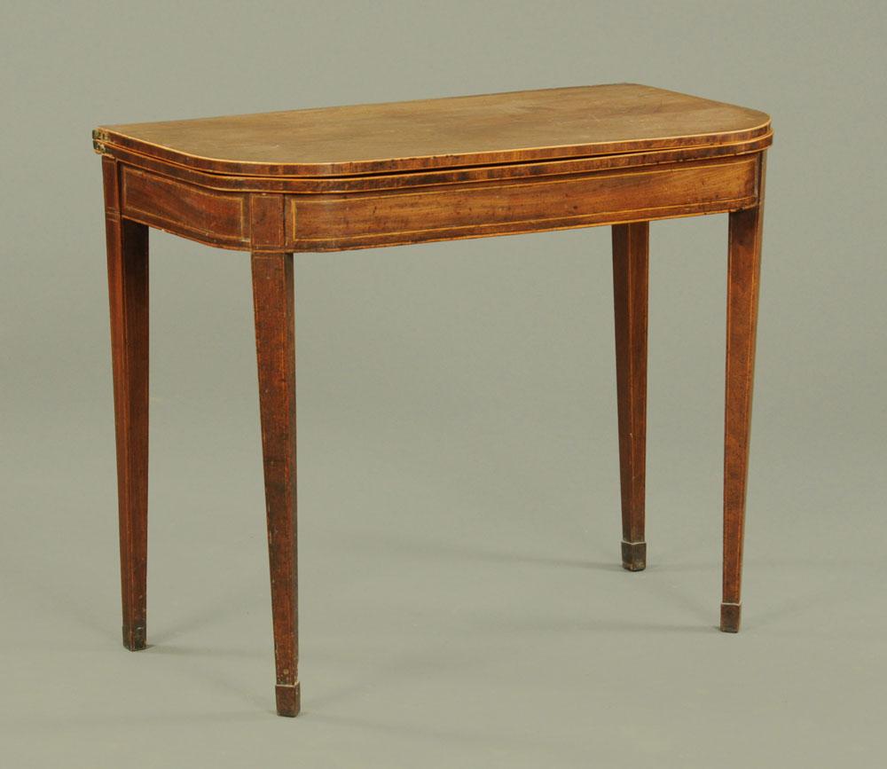 A George III mahogany turnover top boxwood strung tea table,