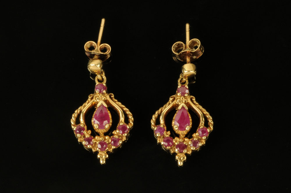 A pair of 9 ct gold ruby and diamond drop earrings, stamped 375.