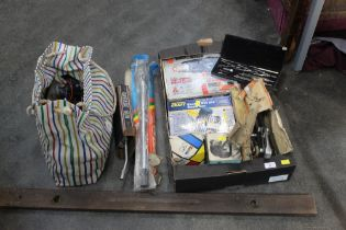 Box and a bag of tools: spirit level, hot air gun, nail gun, gear puller ect.