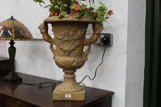 Decorative plastic urn and plants