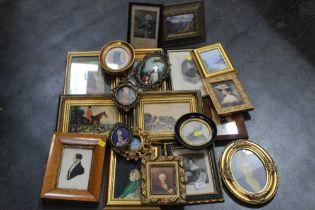 Two boxes of decorative pictures portraits, landscapes etc.