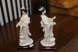 Pair of ornamental figurines, 33 cm high.