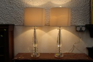 Pair of glass effect table lamps and shades, height 66 cm.