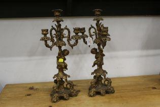 Two gilt metal three branch candelabras
