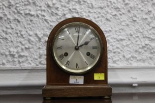 Small early 20th century mantel clock with silvered dial, 18 cm wide, 21 cm high.