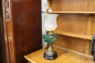 Converted Victorian lamp with green glass painted reservoir, chimney and shade, +/- 59 cm high.