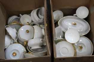 Two boxes of white china with gilded edges, mixture of Worcester, Wedgwood and others.