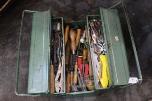 Green foldout toolbox and tools, wood chisels, pliers, spanners, scribe etc.