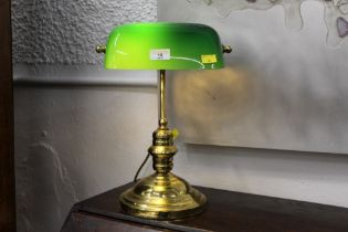 Brass effect desk lamp with green glass shade.