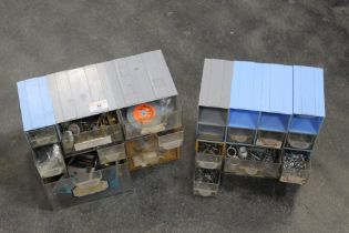 Two sets of small drawers containing nuts, bolts, fuses,