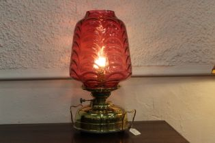 Victorian Veritas oil lamp converted to electric with large cranberry glass shade with brass