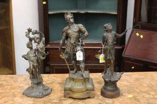 Three metal figurines,
