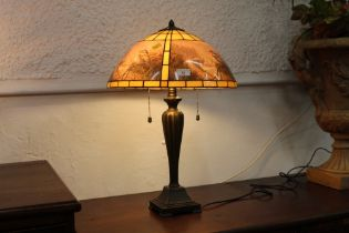 Tiffany style table lamp with bird pattern shade,